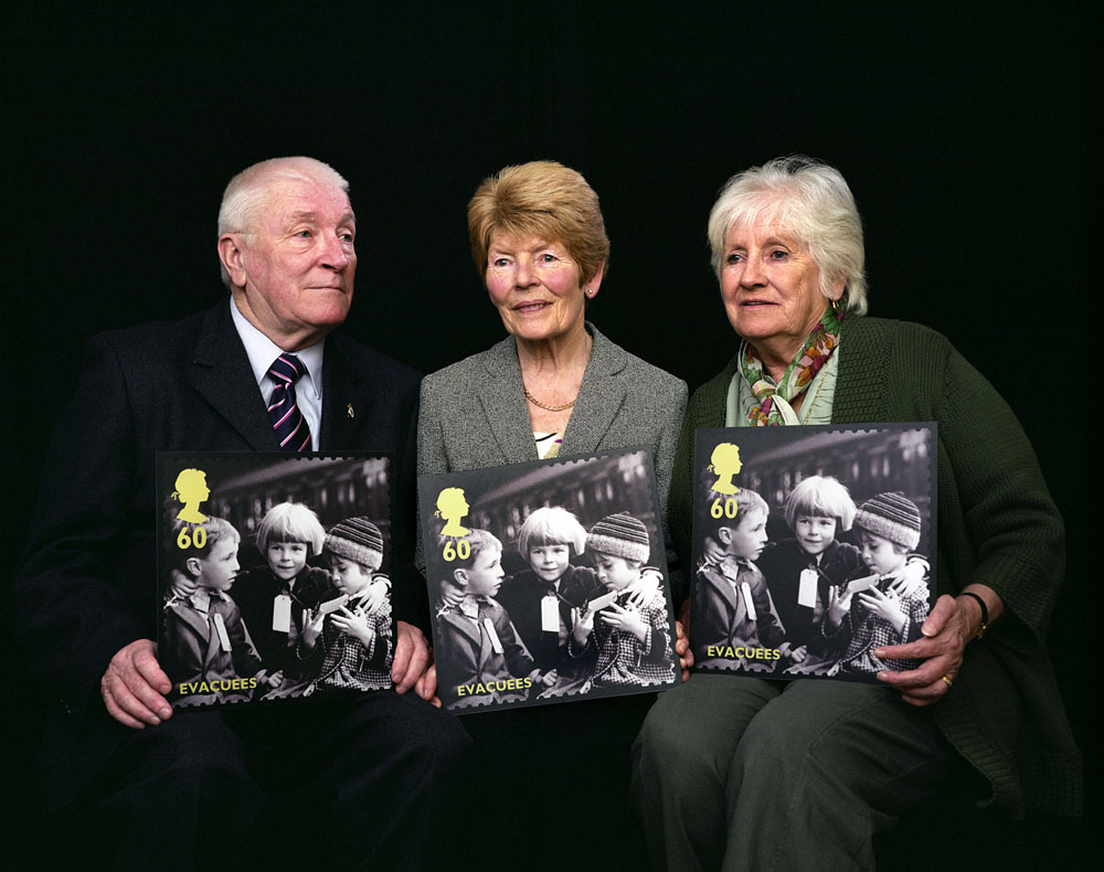 An iconic wartime photograph of three young children taken as they were evacuated from the London blitz during the Second World War is featured on a Royal Mail stamp from the new Britain Alone Stamp Issue. Featuring the Dawson family, Barbara, John and Rosemary, the three siblings now in their 70s, are pictured at Barbara's home in Welling, Kent. [L-R] John Dawson aged 74, Barbara Southend [nee Dawson] aged 76 and Rosemary Brett [nee Dawson] aged 73