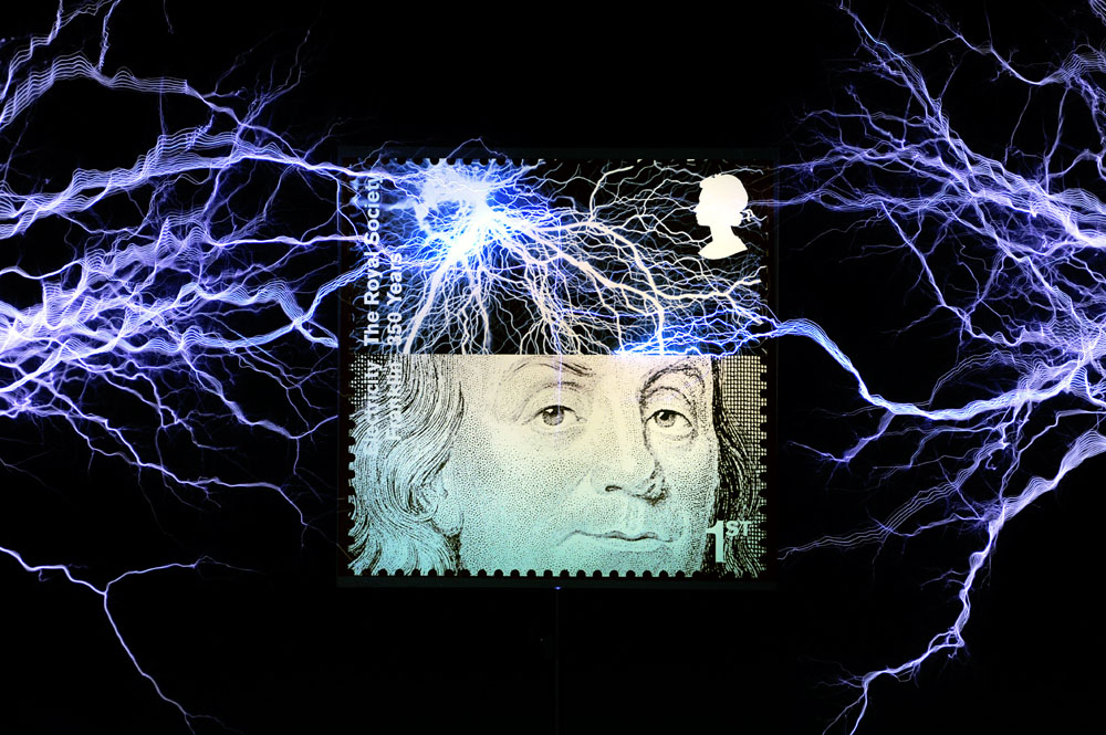 Half a million volts from two Tesla coils, strike the Royal Mail's new Benjamin Franklin stamp. Scientist, inventor, politician and Founding Father of the USA, Franklin was also a Fellow of the Royal Society, whose 350th anniversary was commemorated by this new set of ten 1st Class stamps. Benjamin Franklin's most famous and dangerous experiment used a kite and a metal key to prove that lightning was a form of electricity