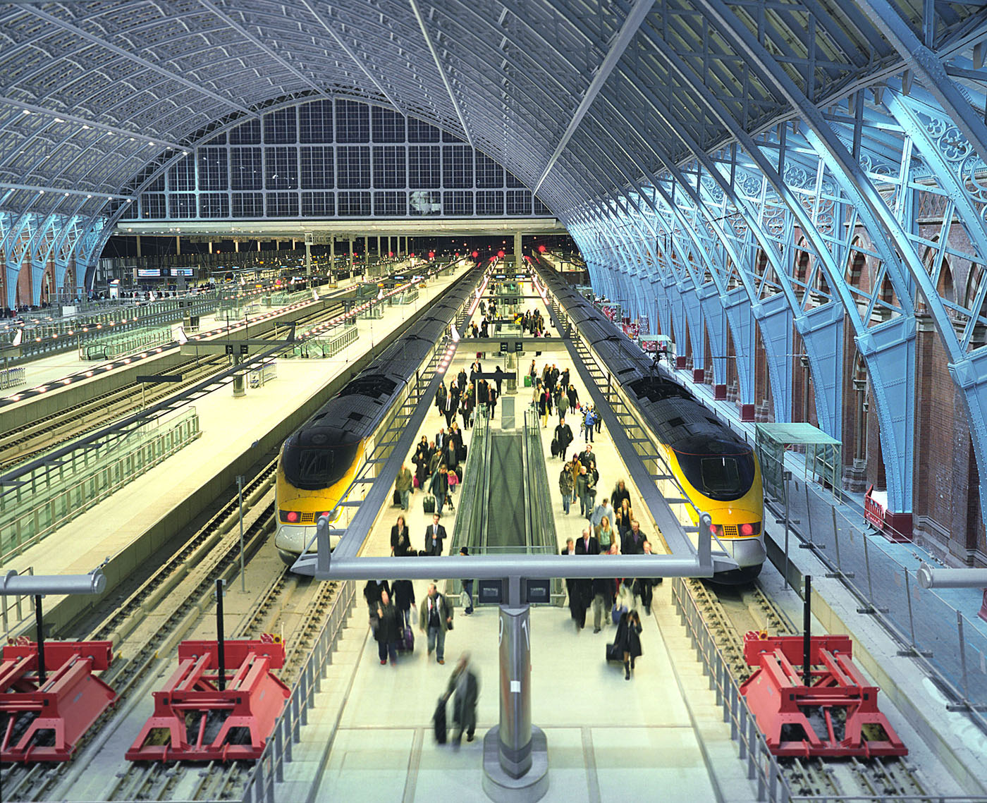 Passengers disembark from Eurostar trains on the first day of service at the Barlow Shed at St Pancras International.