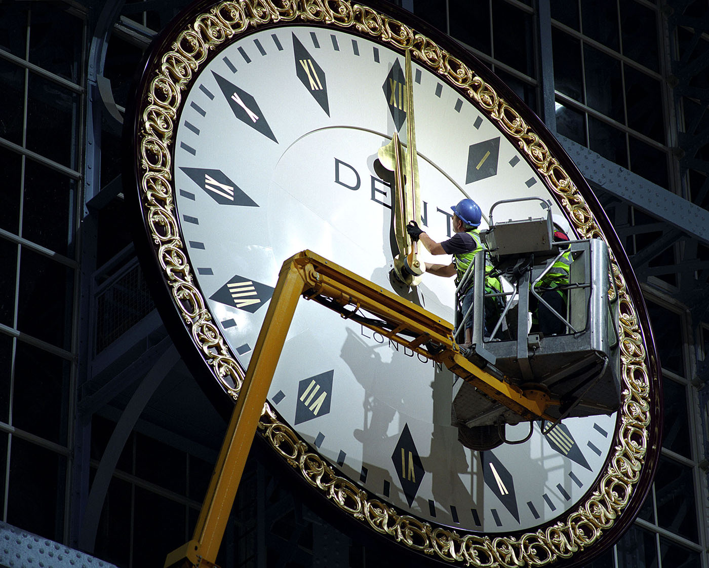 A replica Dent Clock is put into place in the newly restored Barlow Shed at St Pancras International. The original clock is owned by 91 year old Roland Hoggard, who rescued and restored it after it was smashed to pieces as it was removed from the station in the 1970s.