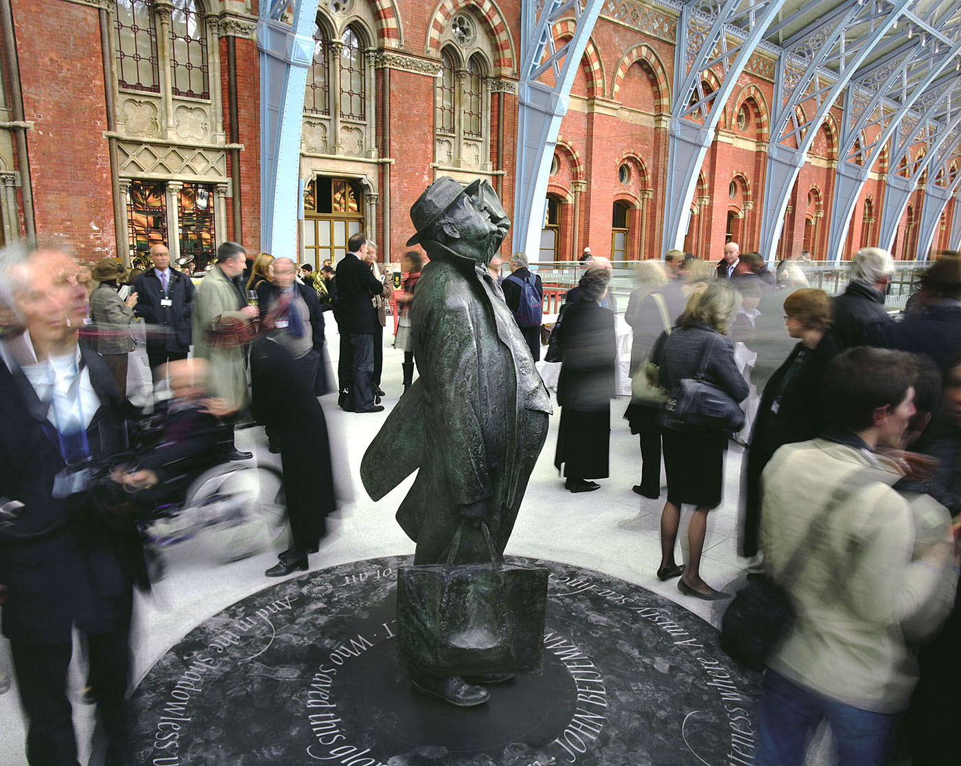The bronze statue of the poet Sir John Betjeman commissioned by London and Continental Railways, sculpted by Martin Jennings, in the newly restored Barlow Shed at St Pancras International.