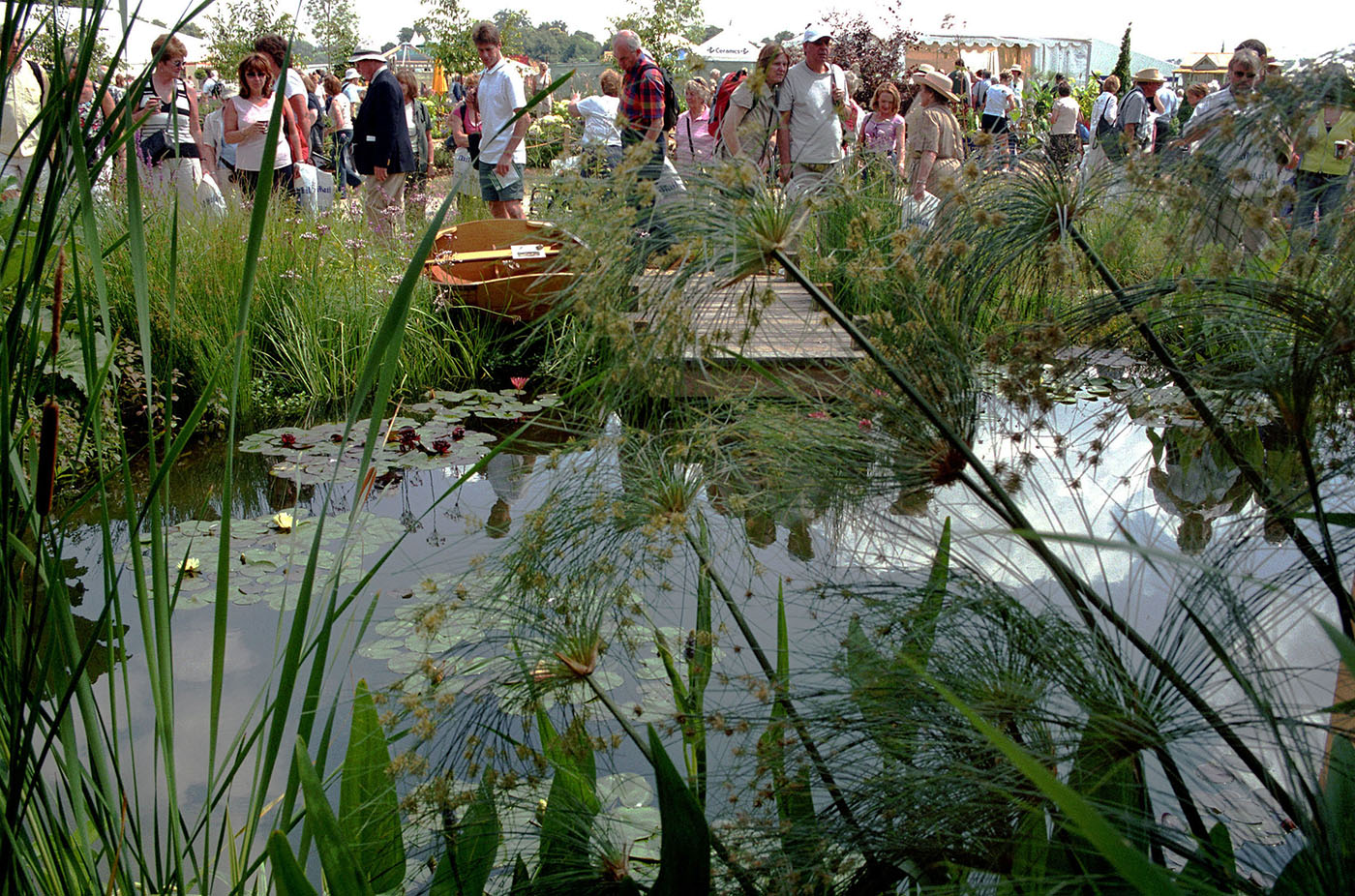 Visitors attend the Royal Horticultural Society's annual Hampton Court Palace Flower Show